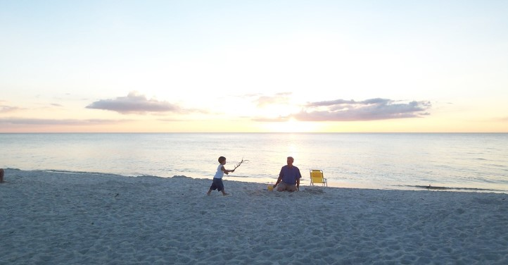 father and son playing on bonita beach